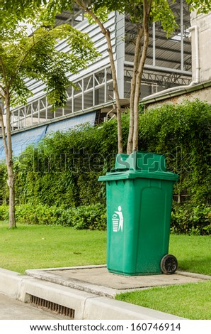 Green garbage, trash bin at park - stock photo