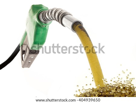 Green gas nozzle wasting fuel with drops on white background