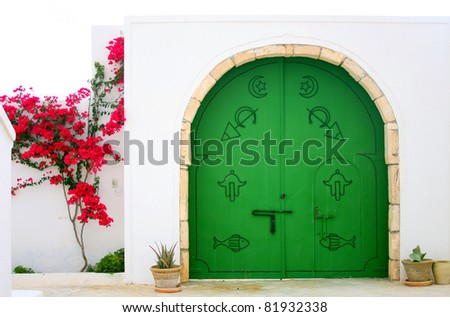 Green gate in Arabic style. - stock photo