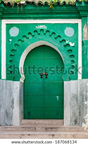 Green gate of ancient mosque in Medina. Tangier, Morocco - stock photo