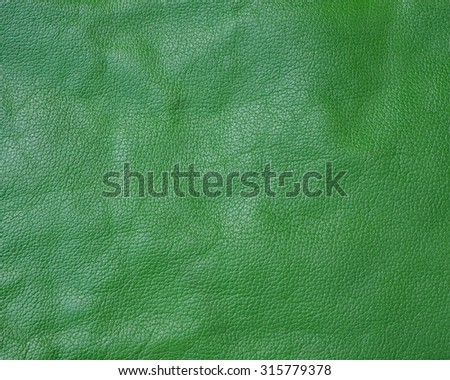 Green genuine leather background - stock photo