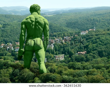 green giant walking in rural ambiance, seen from behind - stock photo