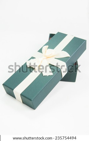 Green gift box with big bow ribbon on white background - stock photo