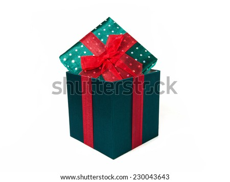 green gift box with red bow on white background