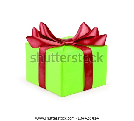 Green gift box with red ribbon bow isolated on white background.