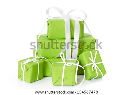 Green gift boxes isolated on white for christmas tied with white ribbon. - stock photo