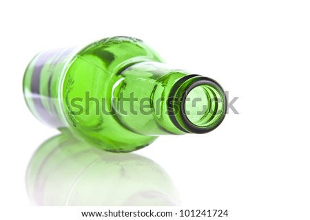 Green glass bottle isolated on a white background - stock photo