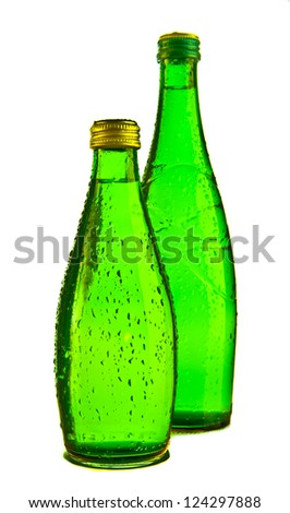 Green Glass bottle of soda water. Isolated on white background