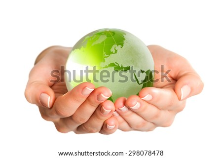 Green glass globe in hand isolated - stock photo
