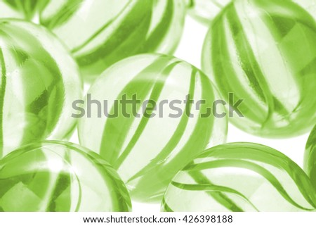 Green  glass marbles on white background. Macro image - stock photo