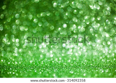 Green glitter background - defocused lights or bokeh background - stock photo