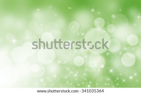 Green glitter sparkles defocused rays lights bokeh abstract background.