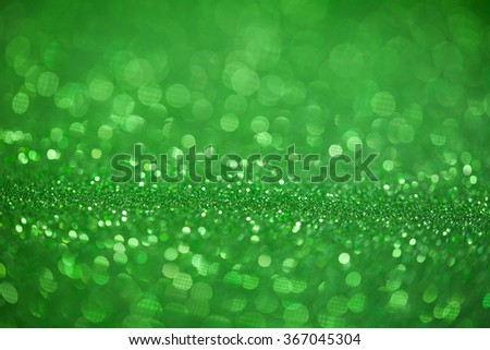 Green glitter surface with green light bokeh - It can be used for background for special occasions promotion campaign or product display - stock photo