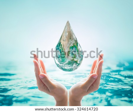 Green globe droplets over female human hands with clear turquoise blue background: Save water, save earth and green environment protection/ campaign concept: Elements of this image furnished by NASA   - stock photo