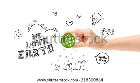 Green globe in hand and environmental drawing (Environment concept) - stock photo