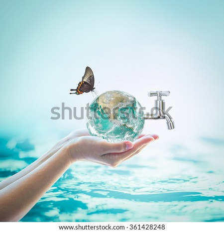 Green globe in woman human hand w/ water tab, butterfly blur natural blue ocean background World environmental protection concept: Saving water conceptual csr idea: Element of  image furnished by NASA - stock photo