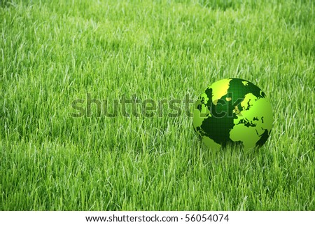 green globe on grass - stock photo