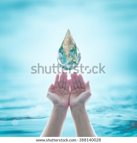 Green globe water droplet fall on women human hands from sky on blur blue sea ocean background: World environmental protection: Saving aqua conceptual csr idea: Element of this image furnished by NASA - stock photo