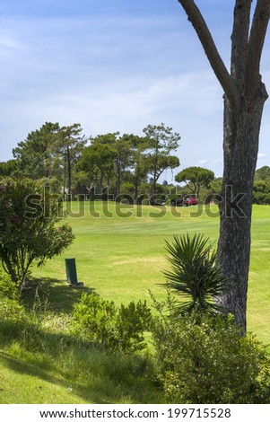 Green golf course and blue sky in south of Portugal - stock photo