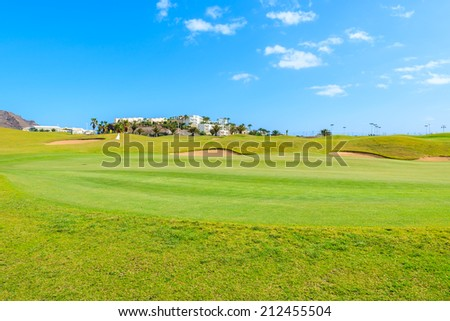 Green golf course area in Las Playitas town, Fuerteventura, Canary Islands, Spain  - stock photo