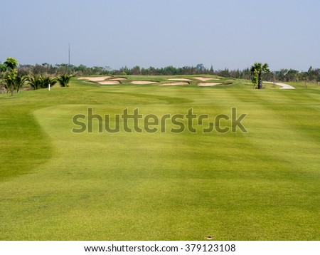Green golf field . Asian landscape.