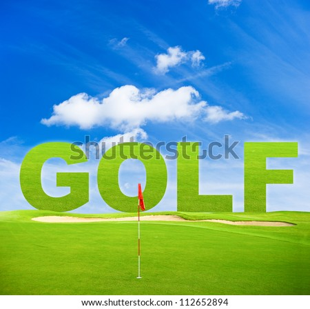 green golf field with red flag and blue sky background - stock photo