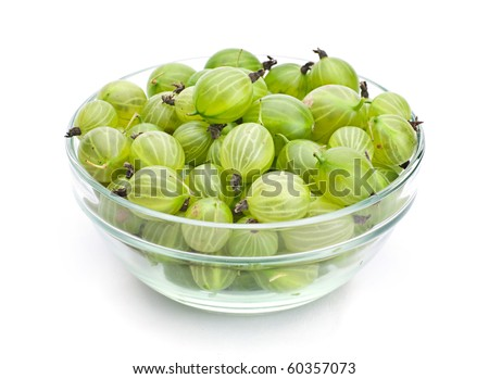 Green gooseberry fruit in glass plate on white