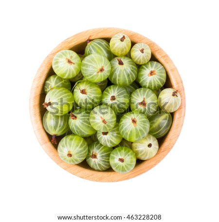Green gooseberry in a bowl isolated
