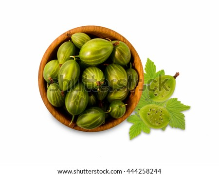 Green gooseberry in a wooden bowl. Top view. Ripe and tasty gooseberry isolated on white background. - stock photo