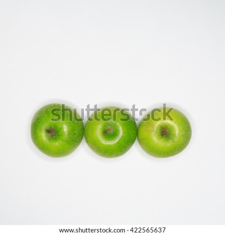 Green Granny Smith apples on white background.