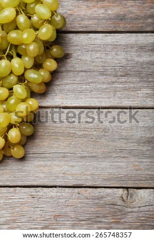 Green grape on grey wooden background