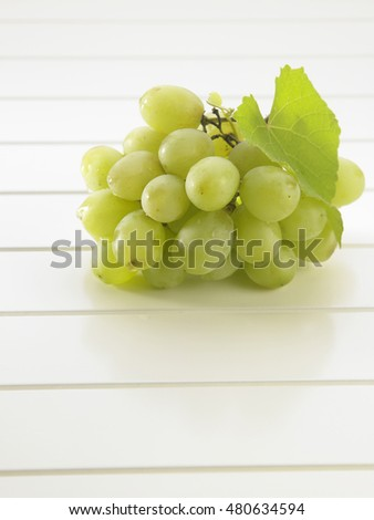 green grape on the white table