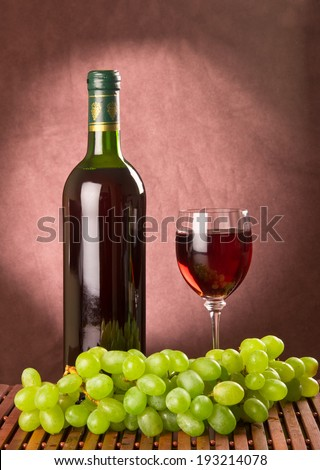 Green grapes and red wine in bottle and wine glass