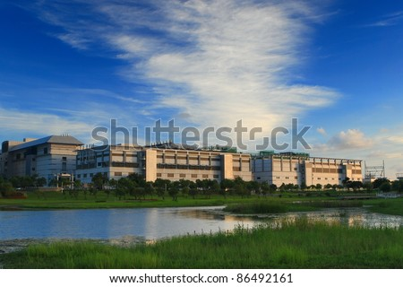 green grass and lake with high technology factory shot in Taiwan / Formosa Tainan City Environmental science and technology park - stock photo