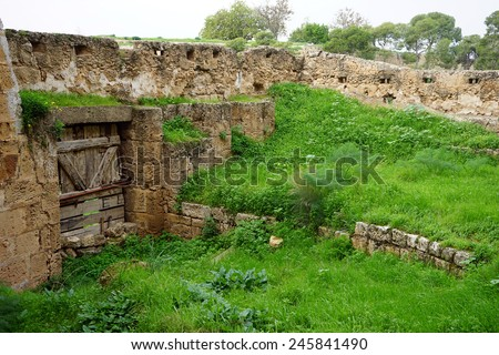 Green grass and ruins of fortress in Famagusta, North Cyprus                                - stock photo