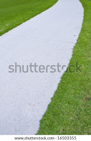 Green grass and white road. a little curved line.