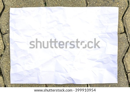 green grass background with white paper