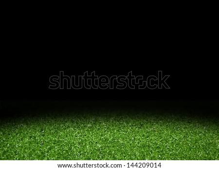 Green grass field with spotlight - stock photo