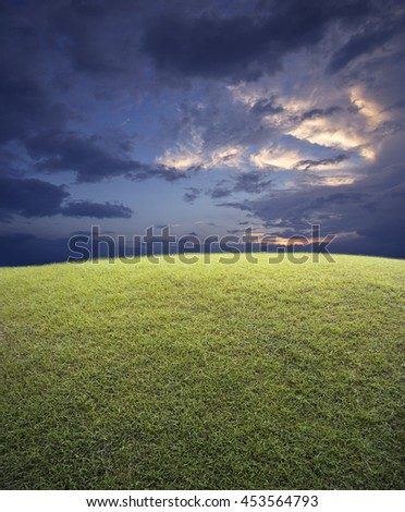 Green grass field with sunset sky, nature background