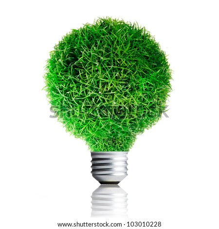 Green Grass growing on Light bulb. Concept for eco-friendly - stock photo