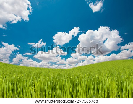 Green Grass hill and beautiful sky and clouds - stock photo