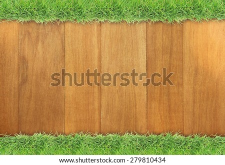 Green grass on wood background