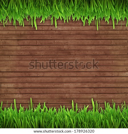 green grass on wooden background image in a frame