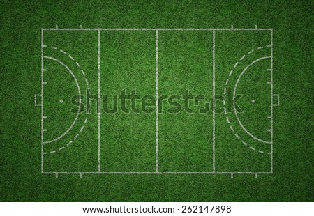 Green grass pitch of field hockey with white lines marking the pitch. - stock photo