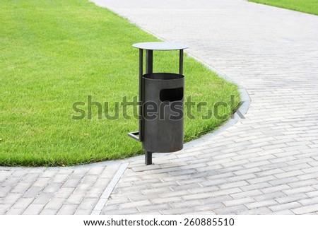 Green grass, refuse bin  - stock photo