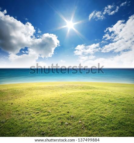 Green grass river lake sea nature background blue sky landscape - stock photo