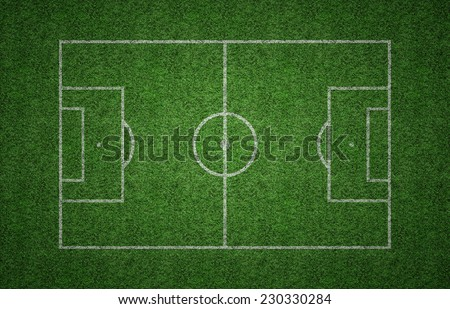 Green grass soccer field with white lines marking the pitch. - stock photo