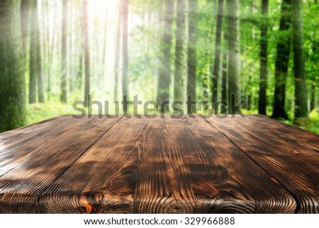 green grass space and wooden table place