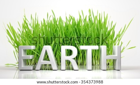Green grass with Earth 3D text, isolated on white background. - stock photo