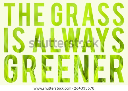 Green grass with typography quote about the grass always being greener on the other side. - stock photo
